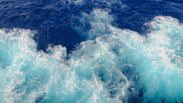 Sea water with air swirls in the Eastern Mediterranean Sea creating blue and white patterns
