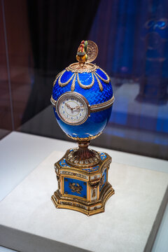 Saint Petersburg, Russia - ca. December 2017: Blue Faberge Easter Egg with a Clock Dial and a Cockerel called Kelch Chanticleer Egg at the Faberge Museum in the Shuvalov Palace.