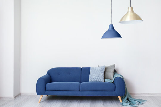 Interior of modern room with blue sofa