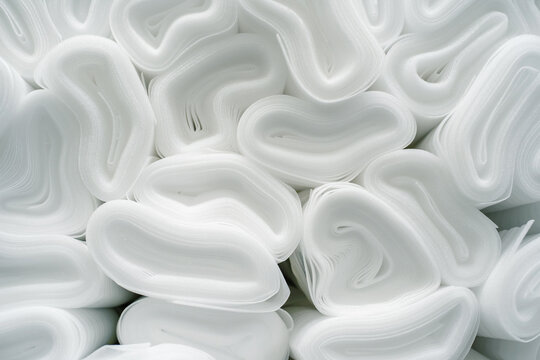 Insulation in rolls made of expanded polypropylene. Polymer base for laminate and flooring. Close-up