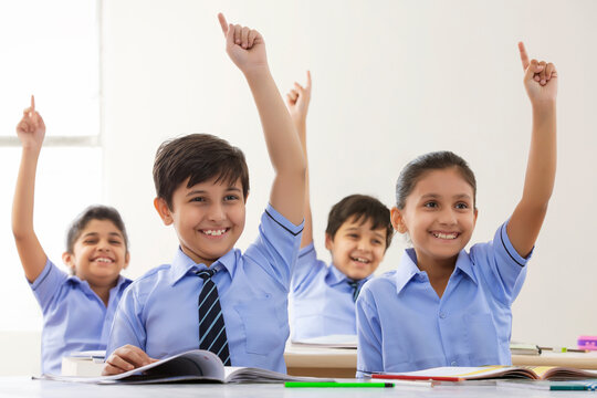 children raising their fingers up in class