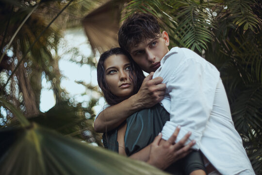 Scared Couple Standing in the Tropical Jungle