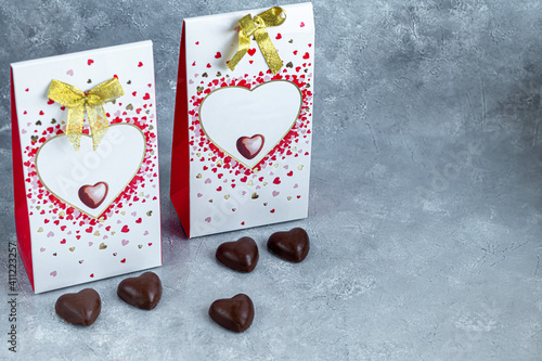 Mother's day, women's day, Valentine's day or birthday on gray background. Gifts, sweets in the form of hearts.