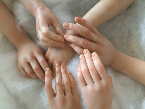High Angle View Of Mannequin Hands On Table