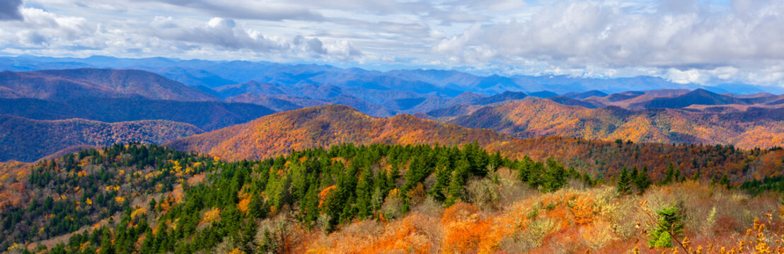 Autumn mountain scenery. A panoramic view of  Smoky Mountains from  Blue Ridge Parkway in North Carolina. Cloudy sky over layers of colorful  hills and  mountains. Near Asheville, North Carolina.