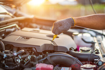 Cropped Hand Of Mechanic Repairing Car