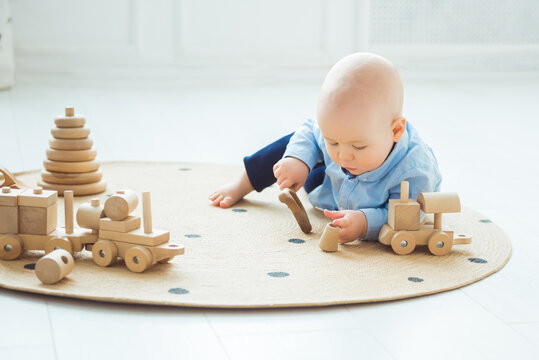 Baby playing with wooden toys. Zero waste, eco friendly concept