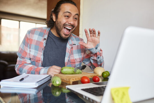 Young mature man taking cooking classes online