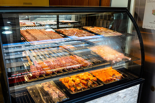 Different types of shish kebab and kebab are on the glass display in the restaurant. They will be prepared for you on the spot.