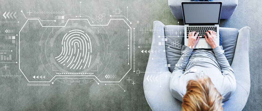 Fingerprint scanning theme with man using a laptop in a modern gray chair