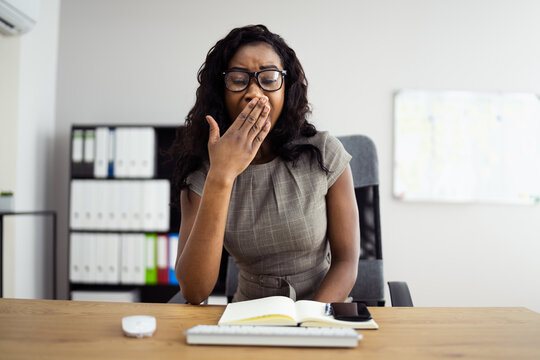 Exhausted Unhappy African Woman In Office