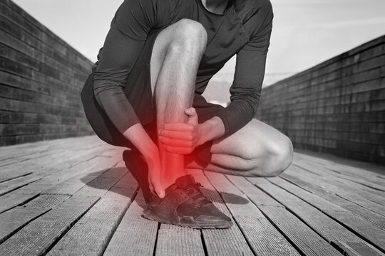 Fitness runner with ankle pain or achilles injury. Ankle twist sprain accident. Running or workout injury