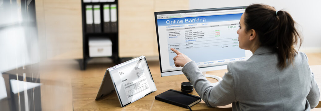Woman Using Online Banking Transfer