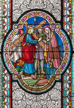 VIENNA, AUSTIRA - OCTOBER 22, 2020: The  Jesus meet his Mother Mary scene on the stained glass in  in church Pfarrkirche Kaisermühlen by  workroom Tiroler Glasmalerei-Anstalt from end of 19. cent..