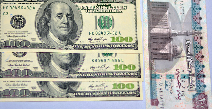 Egypt national currency with USA dollar banknote backdrop. Money banknotes. Egyptian pounds banknotes background. Egyptian money and American dollars exchange rate