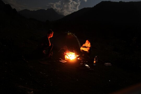 People By Campfire At Night