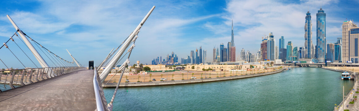 DUBAI, UAE - MARCH 27, 2017: The skyline with the bridge over the new Canal and Downtown.