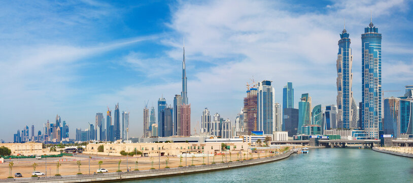 Dubai - The skyline with the bridge over the new Canal and Downtown.