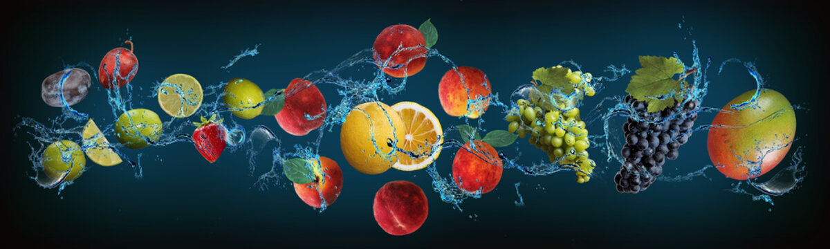 Panorama with fruits in water - plum, lime, peach, lemon, grapes, mango - balance of health and pleasure for people