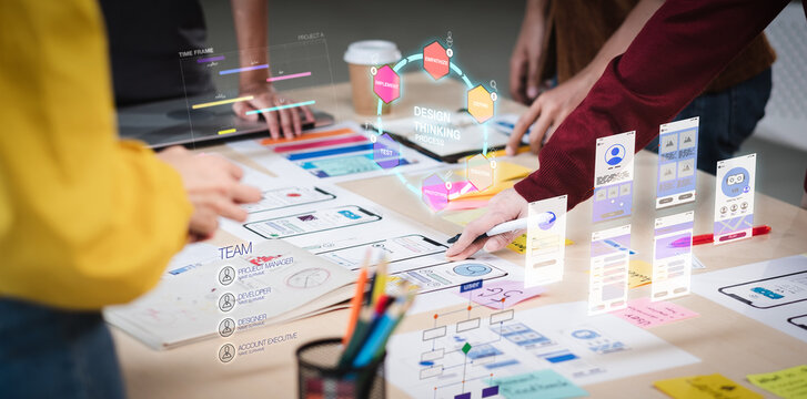 Close up ux developer and ui designer use augmented reality brainstorming about mobile app interface wireframe design on desk at modern office.Creative digital development agency