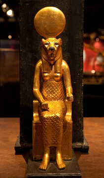 Religion of Ancient Egypt. Sekhmet - Goddess of the scorching sun, war and healing. Ancient Egyptian goddess with the head of a lioness. Gold statue