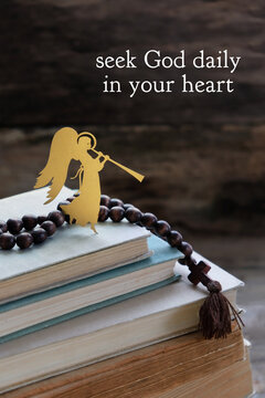 seek God daily in your heart - religious quote. angel, rosaries and old prayer books. Easter, Palm Sunday, faith, orthodox Church, lent, religion concept.