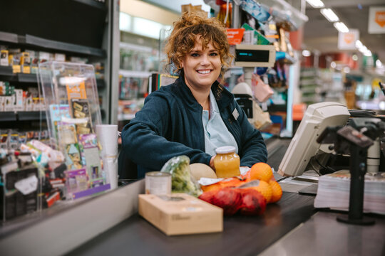 Woman working in modern supermarket
