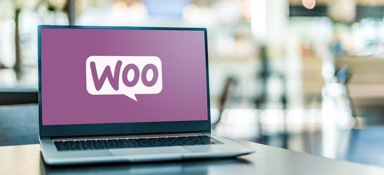 Laptop computer displaying logo of WooCommerce