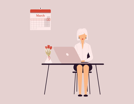 March 8 International Women's Day.Cute blonde woman in white blouse and black skirt work on laptop.Vase with tulips on desk.Smart lady trainer,coach or accountant conduct webinar or workshop.Raster