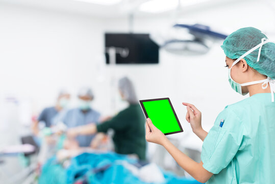 asian woman doctor use digital tablet in operating room