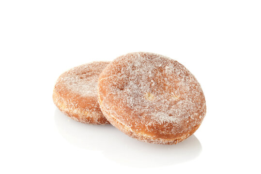 two paczki donuts on white