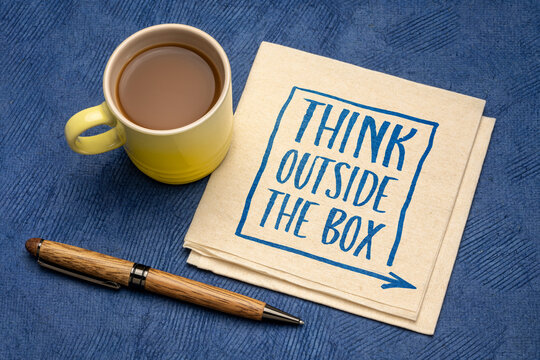 think outside the box - inspirational concept - handwriting on a napkin with a cup of coffee, business, education and personal development