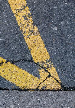 yellow road markings on grey asphalt