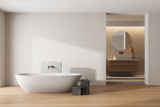 White bathroom interior with a white tub, sinks and round mirrors. mock up