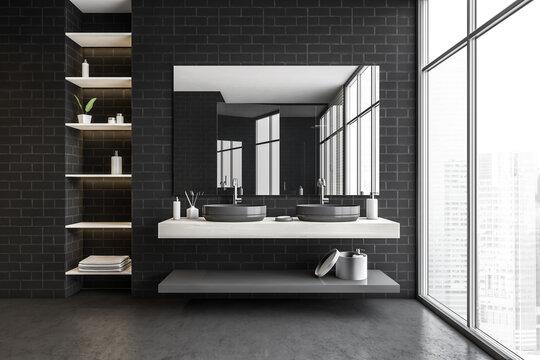 Black brick bathroom with two sinks, shelves, mirror and big window