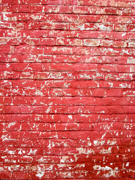 Redbrick wall with scuffs. Vertical retro background for a stylized poster.
