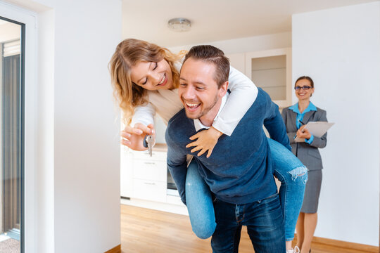 Woman and man being extremely happy about their new home