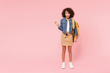 Full length happy little african american kid school girl 12-13 year old in casual denim clothes...