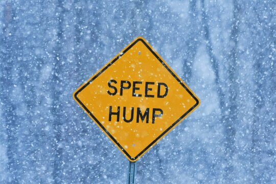 Speed hump sign in snow