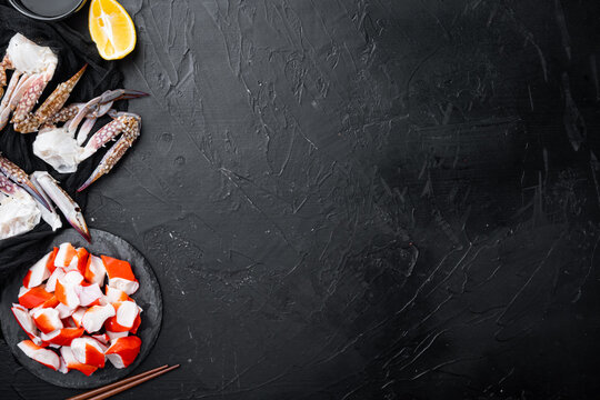Fresh Crab meat surimi with blue swimming crab, on stone board, on black background, top view flat lay  , with copyspace  and space for text