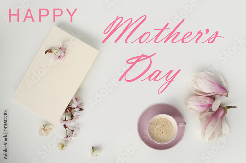 beautiful tender flat still life, card on a beige background for mother's day, magnolia buds, cup of cappuccino, concept of floral spring background