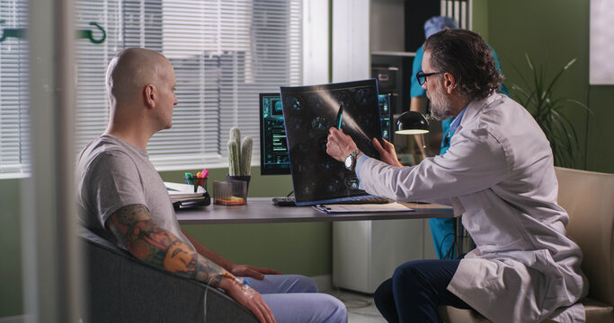Doctor delivering bad news to patient during chemotherapy