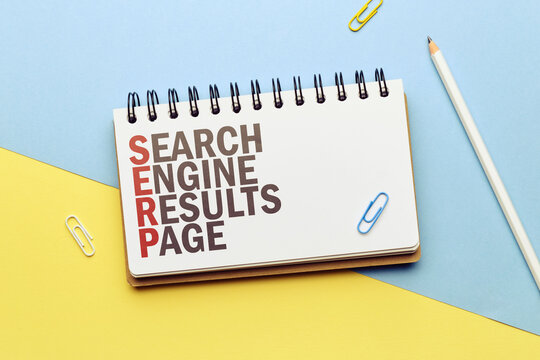 Marketing buzzword serp. Term Search engine results page on notepad