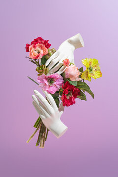 Plastic woman hands holding colorful flower bouquet. Minimal modern creative Valentines or Woman's day concept. Retro style new vintage.
