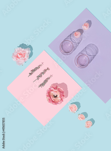 Creative natural minimal flat lay layout with flowers and glasses. Mother's day concept background design.