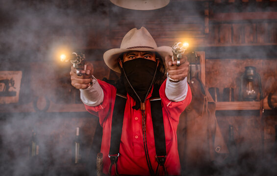 Cowboy posing with rifle gun on hand to show protected weapon ,vintage style.