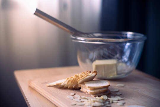 Preparing butter bread on wooden table.