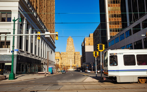 McKinley monument with city hall on Niagara Square and streetcar tram on main street on foreground