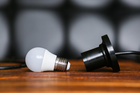 unscrewed lamp near to a cartridge for a lamp. Lack, power outage. Electricity is not supplied to the house, apartment.
