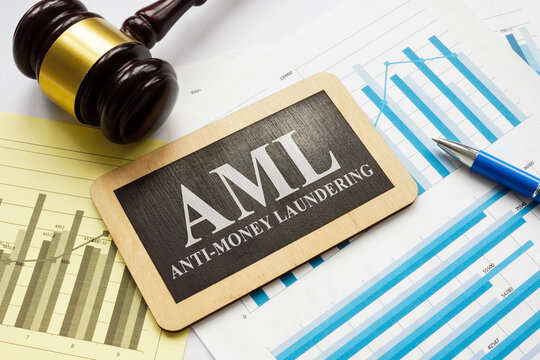 AML anti-money laundering plate and gavel with papers.